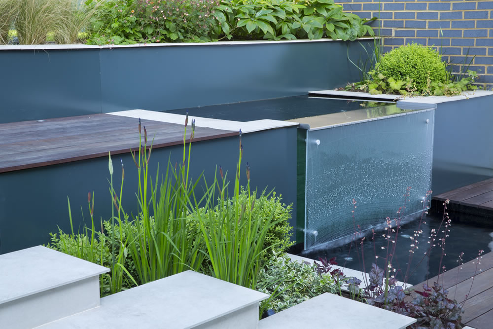 Modern woodland garden design east finchley london n2 for Still pond garden design