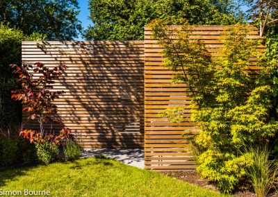 Slatted trellis screens to hide shed