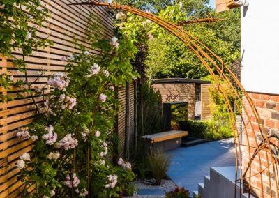Steel arch frames view into garden